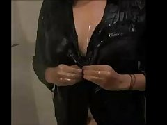 Indian wife in shower opening her wet shirt to take out her big boobs